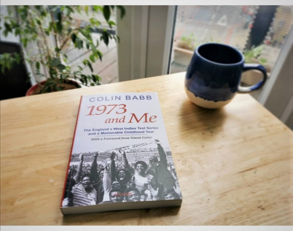 A copy of 1973 and Me with a teacup on a table